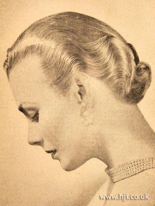 Sleek 1950s waved hairstyle