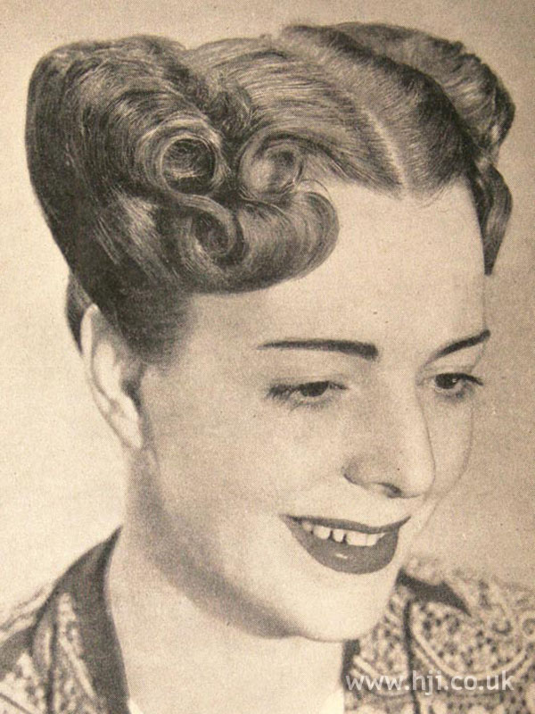 1950s victory roll hairstyle