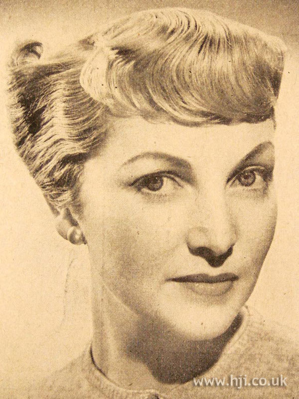1950 short fringe hairstyle with rolls