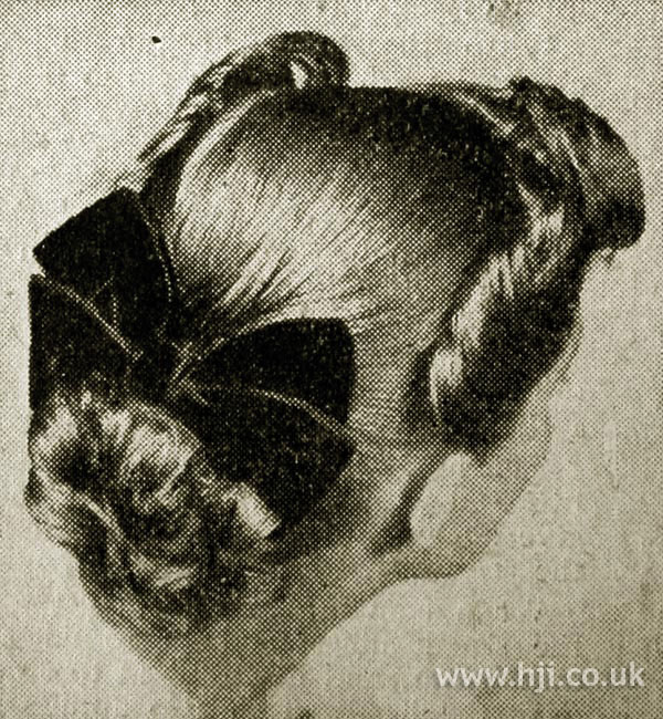 1951 curly bun hairstyle with bow