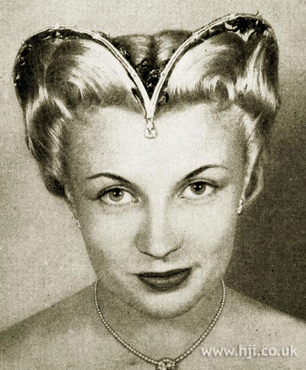 1951 centre parted updo with hair accessory