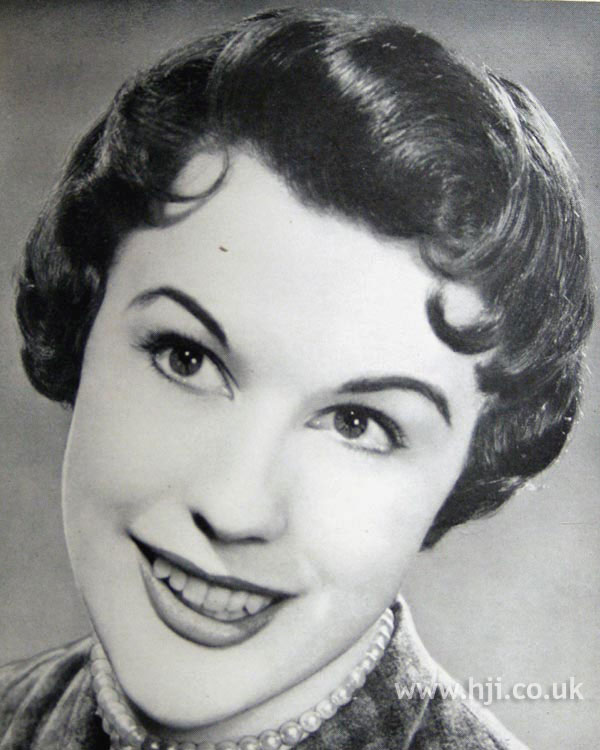 1954 brunette curly hairstyle