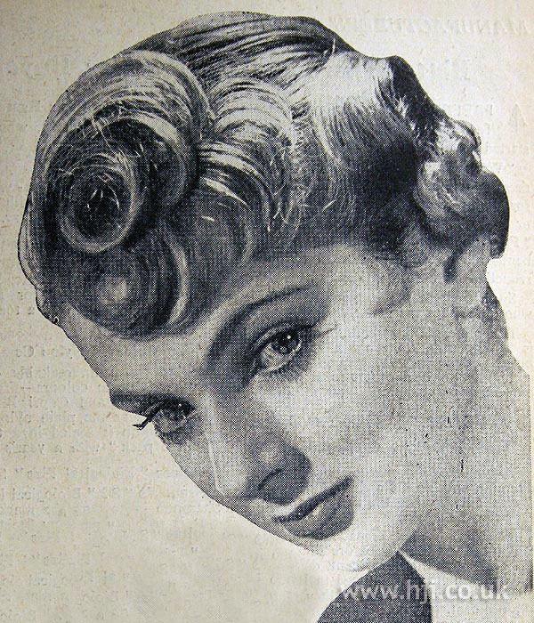 1954 curly updo with fringe