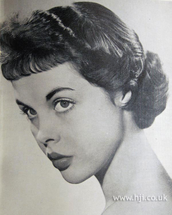 1950s brunette updo with fringe