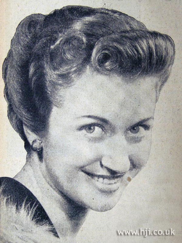 1954 curly updo with rolls