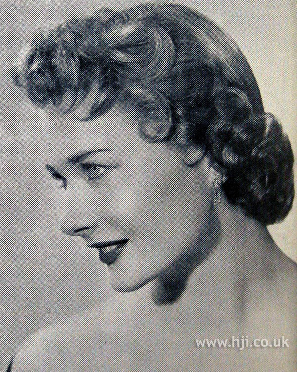 1954 short curly updo hairstyle