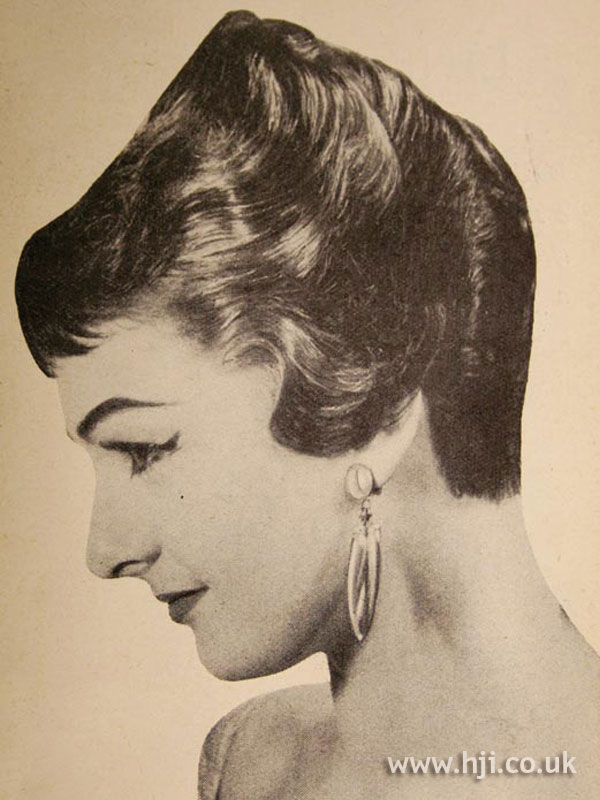 1956 glossy updo with fringe