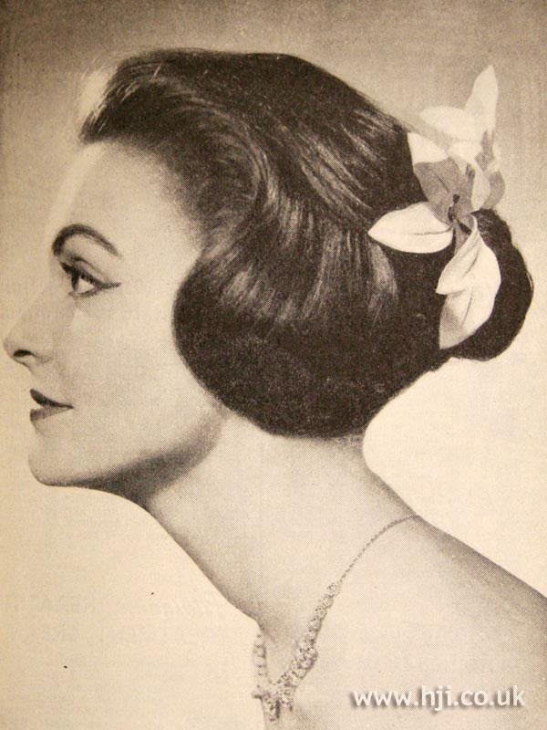 1957 brunette sweeping updo