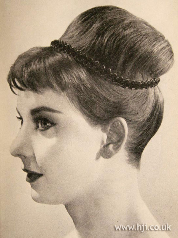 1957 brunette updo hairstyle