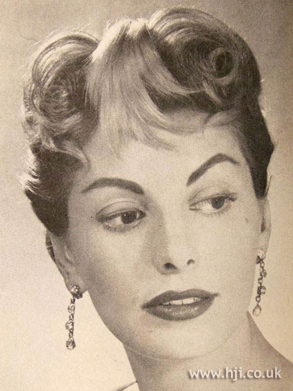 1957 curly updo with fringe