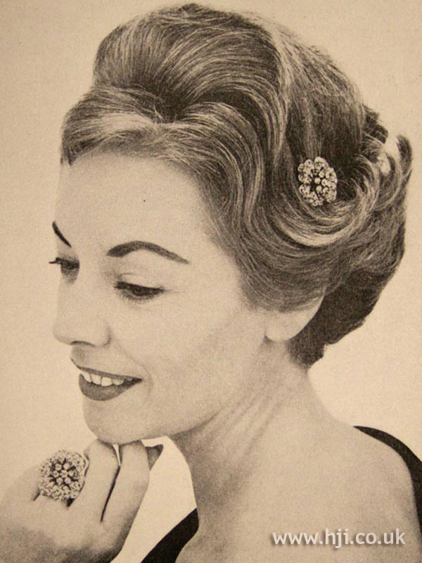 1958 brunette updo with accesory