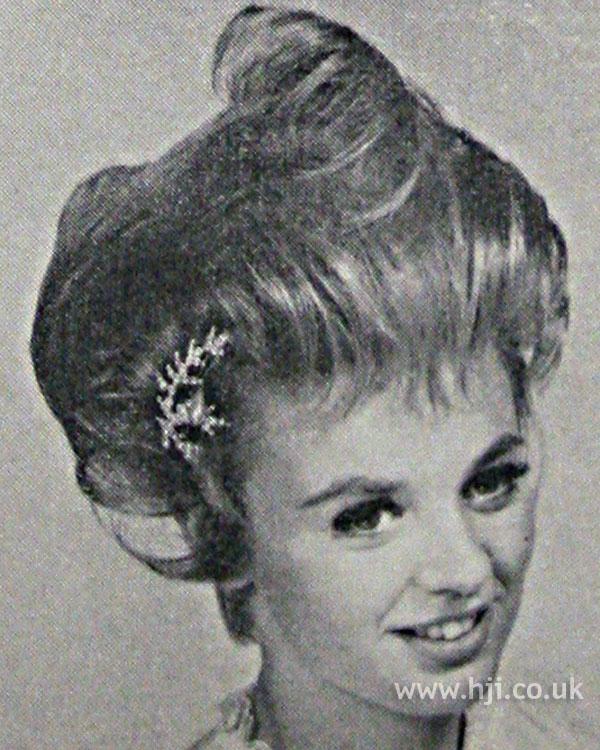 1962 wavy updo with fringe