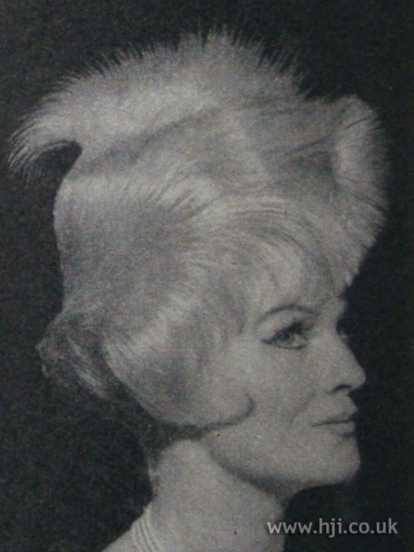 1962 textured blonde updo hairstyle