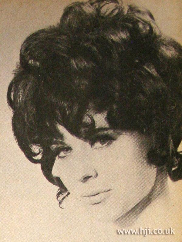 1968 voluminous brunette hairstyle