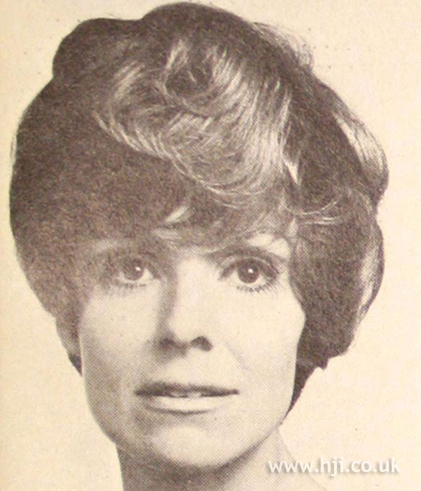 1960s bouffant hairstyle with curly fringe
