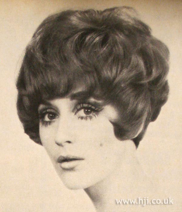 1960s curly bouffant hairstyle with fringe