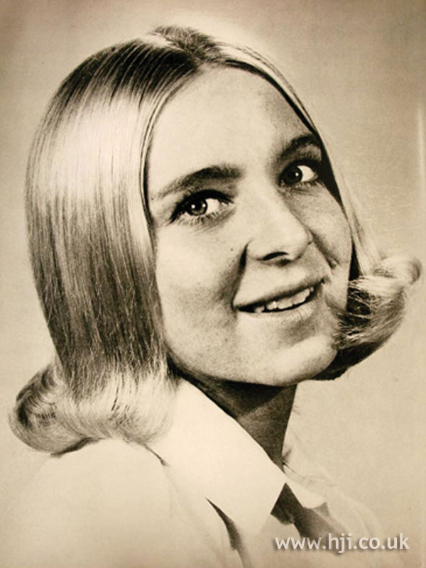 Straight 1960s flicked hairstyle