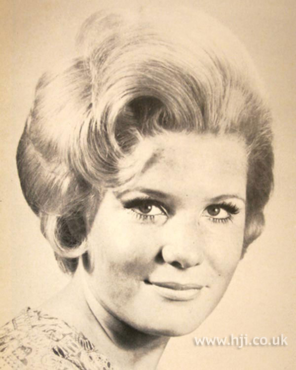 1960s blonde bouffant with curls
