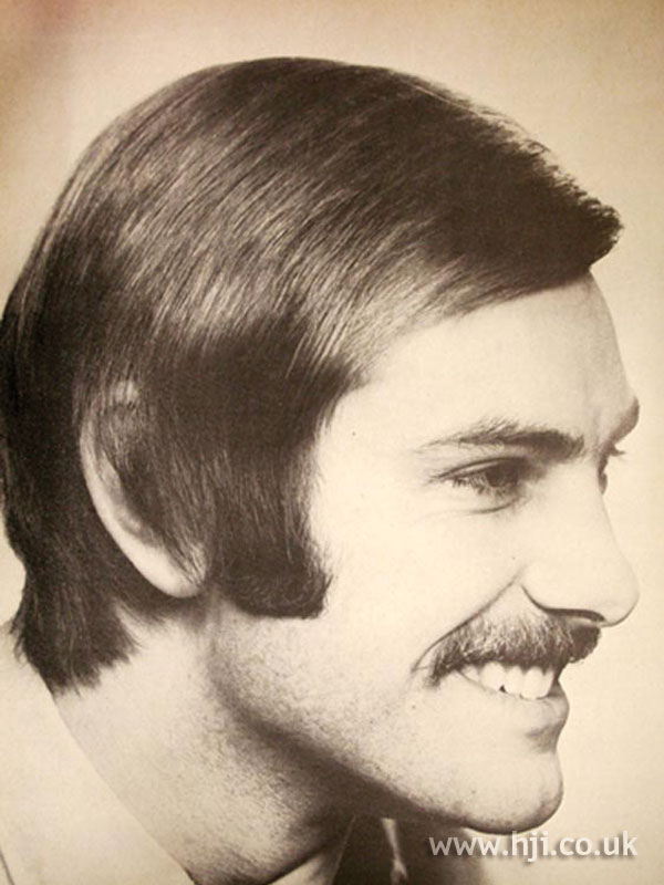 Long 1960s men's hairstyle with sweeping fringe