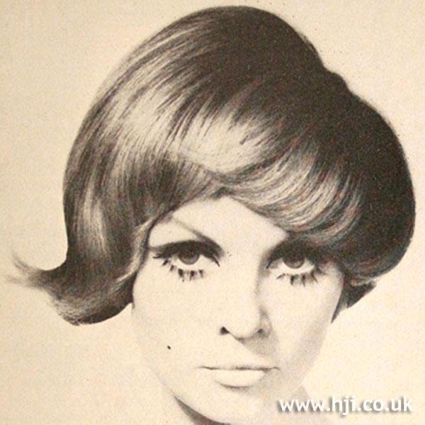 1969 short asymmetric hairstyle
