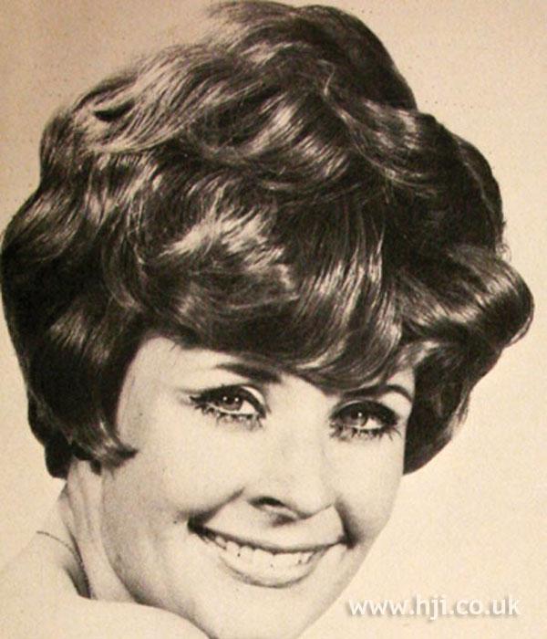 Short wavy women's 1960s hairstyle