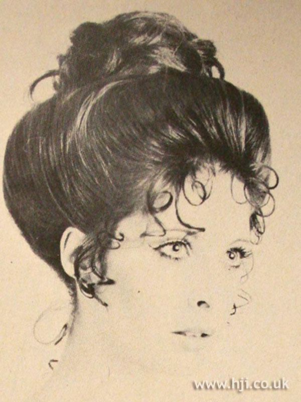 Curly 1960s top-knot updo
