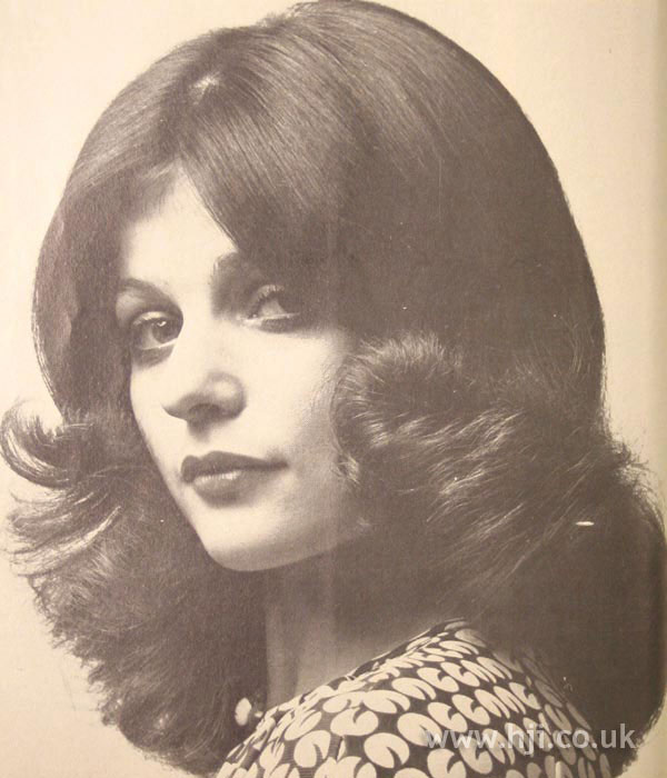 Full 1970s bouffant hairstyle