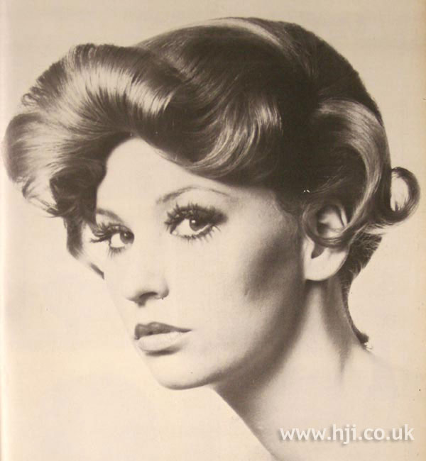 1970s curly updo with rolled fringe