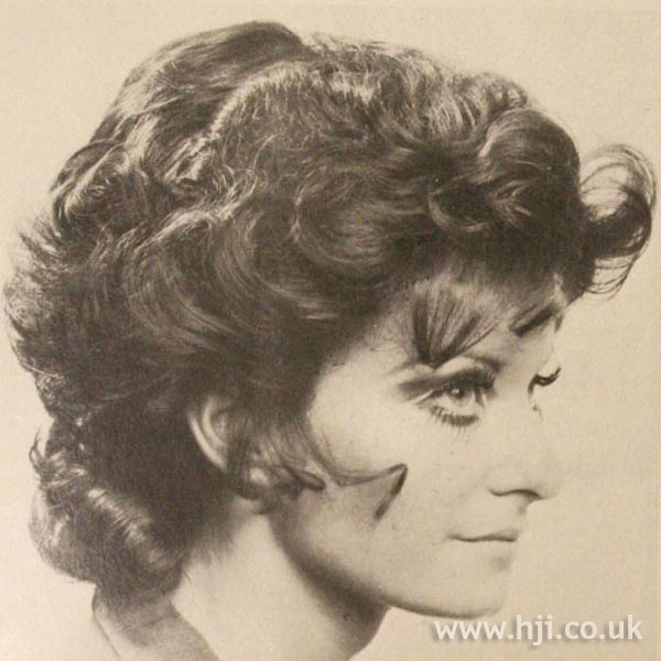 1970s curly blonde hairstyle