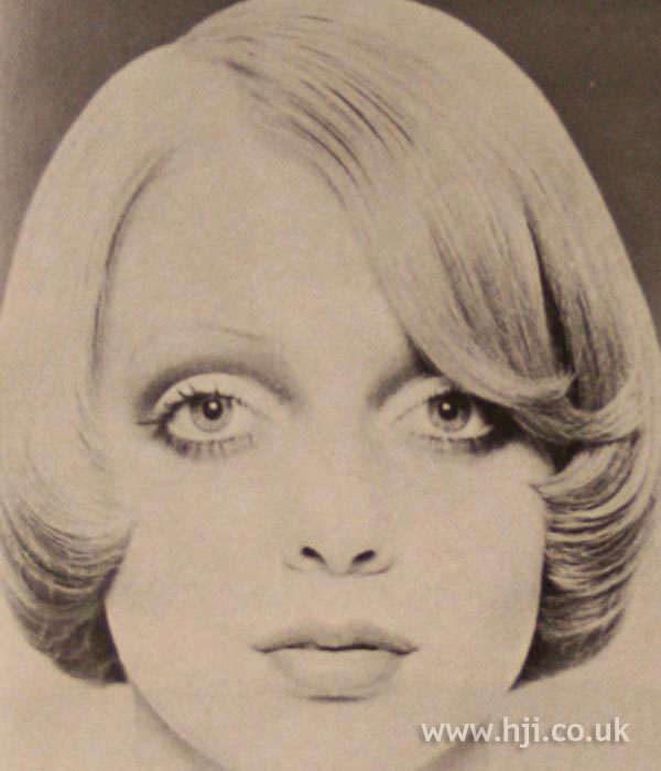 Side-parted sleek 1970s bob
