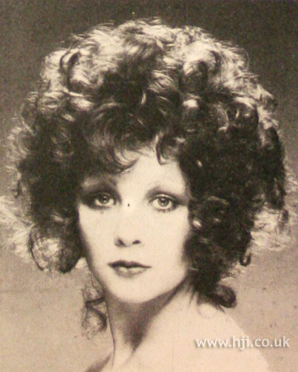 1970s brunette curls hairstyle