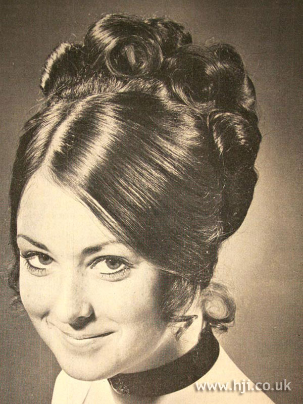 1971 brunette updo hairstyle