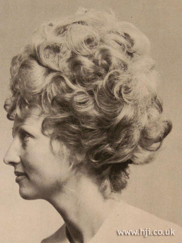 1970s curly bouffant hairstyle
