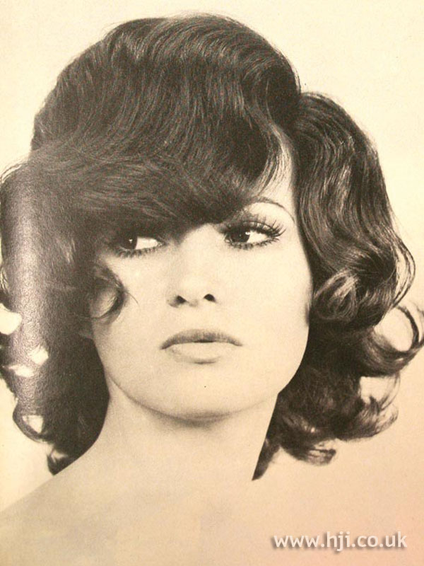 1970s layered curly side-parted hairstyle