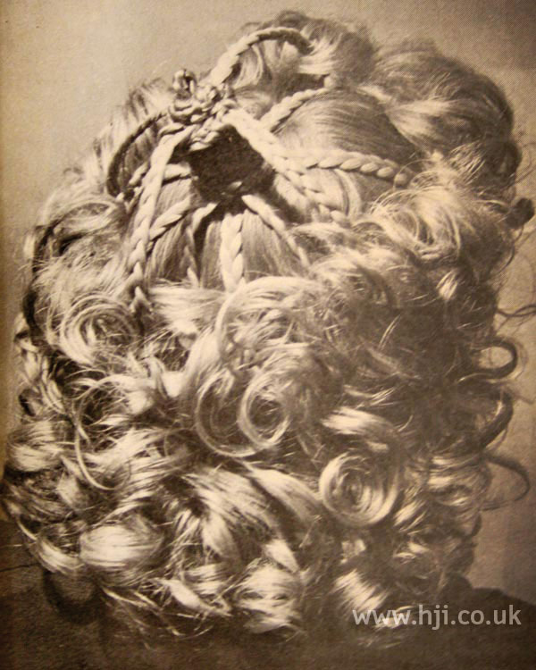 1970s curly hairstyle with plaits
