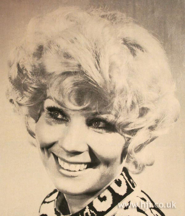1970s curly short blonde hairstyle