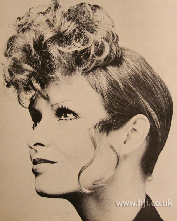 1970s updo with curly fringe
