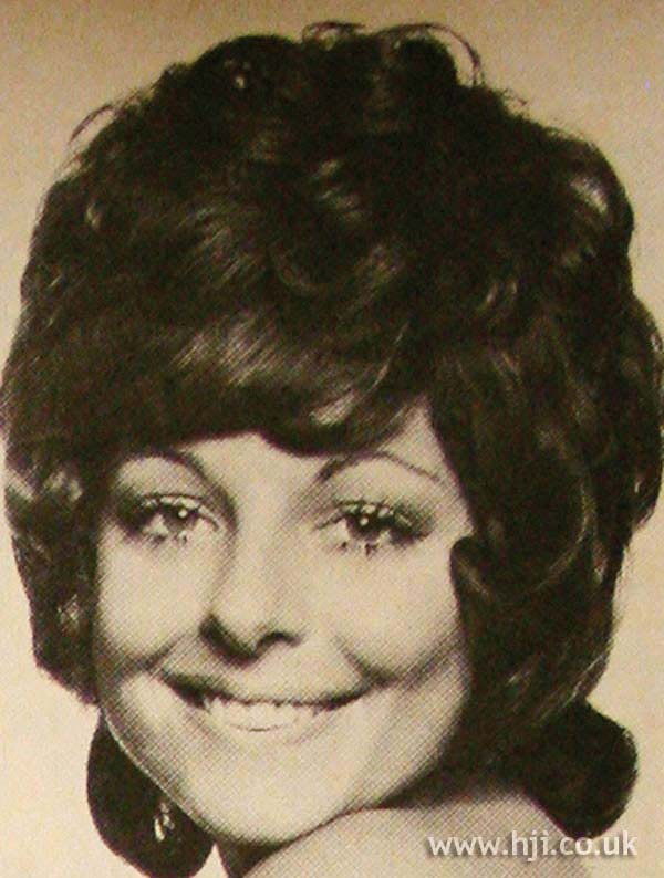 1970s curly fringe hairstyle