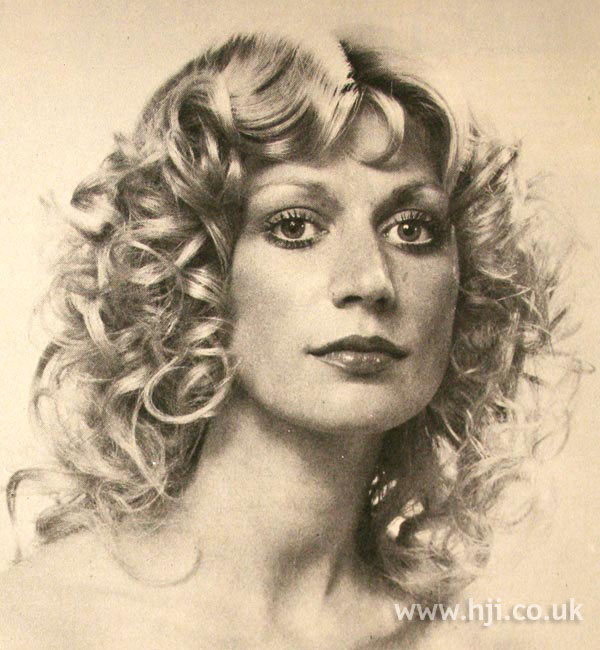 Long curly 1970s hair with fringe