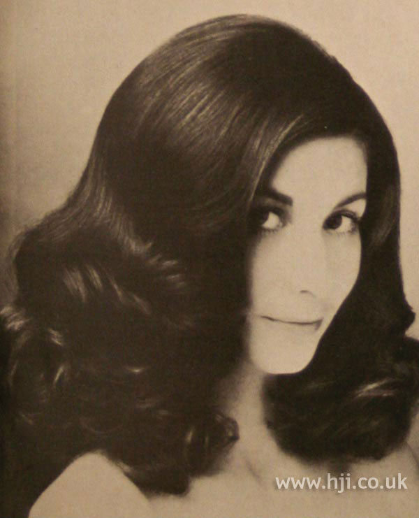 Side-parted long 1970s curls