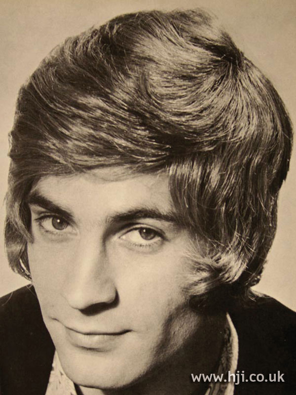 1970s men's hairstyle with sweeping fringe
