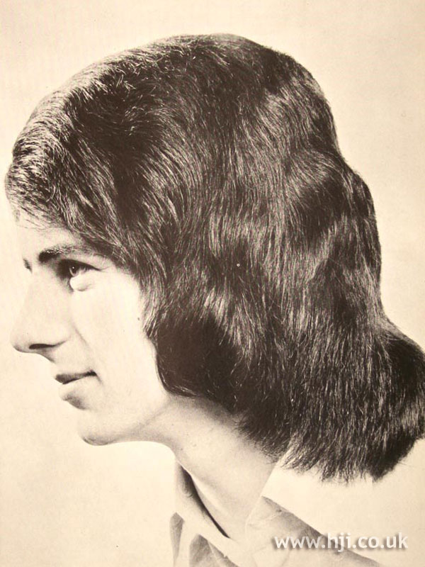 Long layered 1970s men's hairstyle