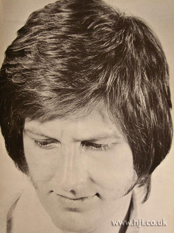1970s side-parted men's hairstyle