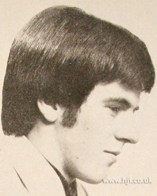 1970s men's hairstyle with sideburns