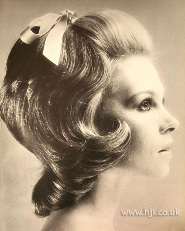 1970s layered mid-length cut with bow