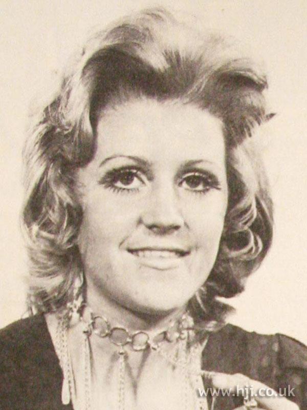 1970s midlength wavy layered cut