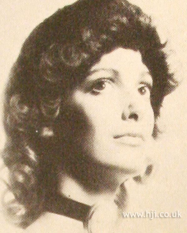 Curly 1970s pageboy hairstyle
