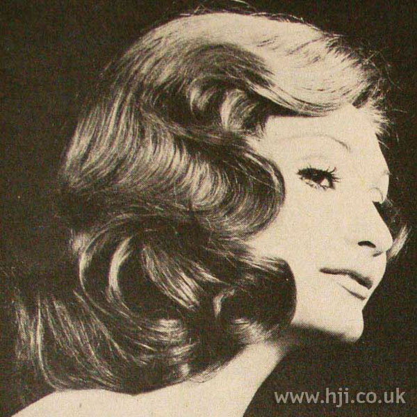 Wavy 1970s midlength hairstyle