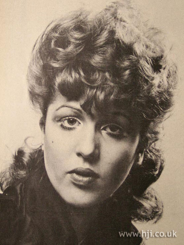 1970s curly perm with fringe detail