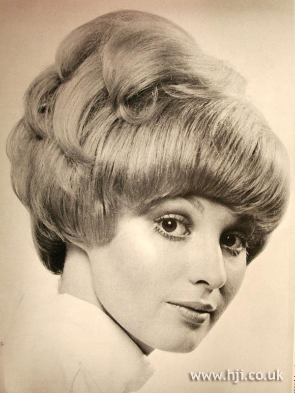 1970s curly updo with fringe